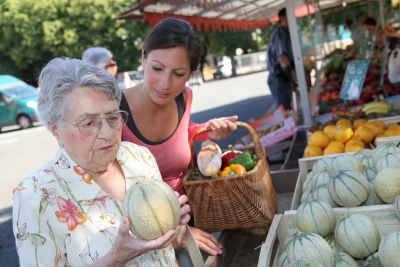 caregiver and senior woman buying fruits and vegetables