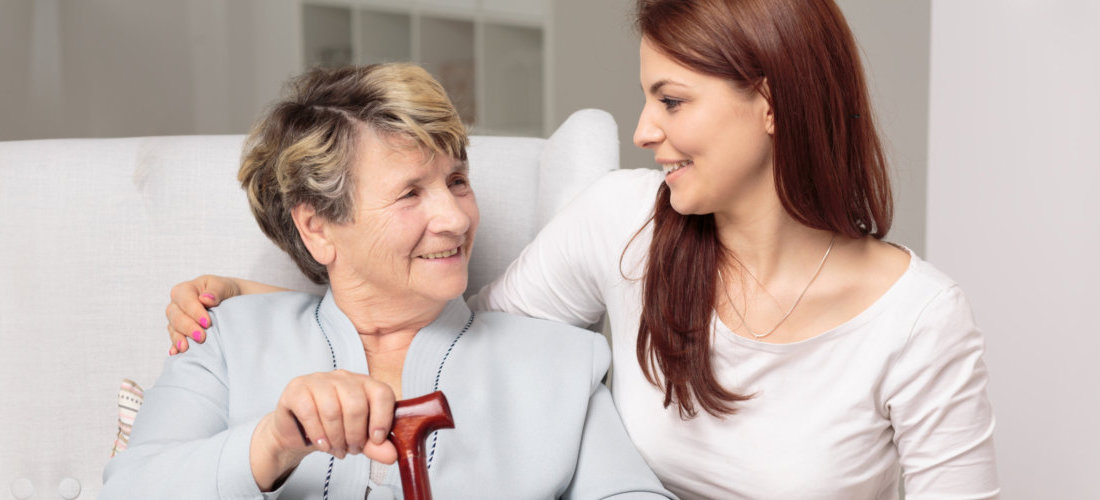 adult woman and senior woman are looking at each other and smiling
